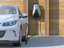 ev vehicle charging car plugged in