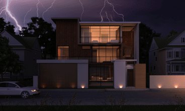 lightening storm above modern house with lights on