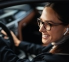 woman smiling while driving car