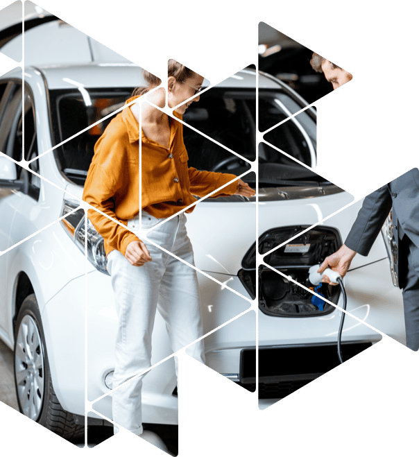 woman and man charging electric car