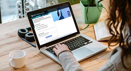 woman viewing qmerit website on laptop