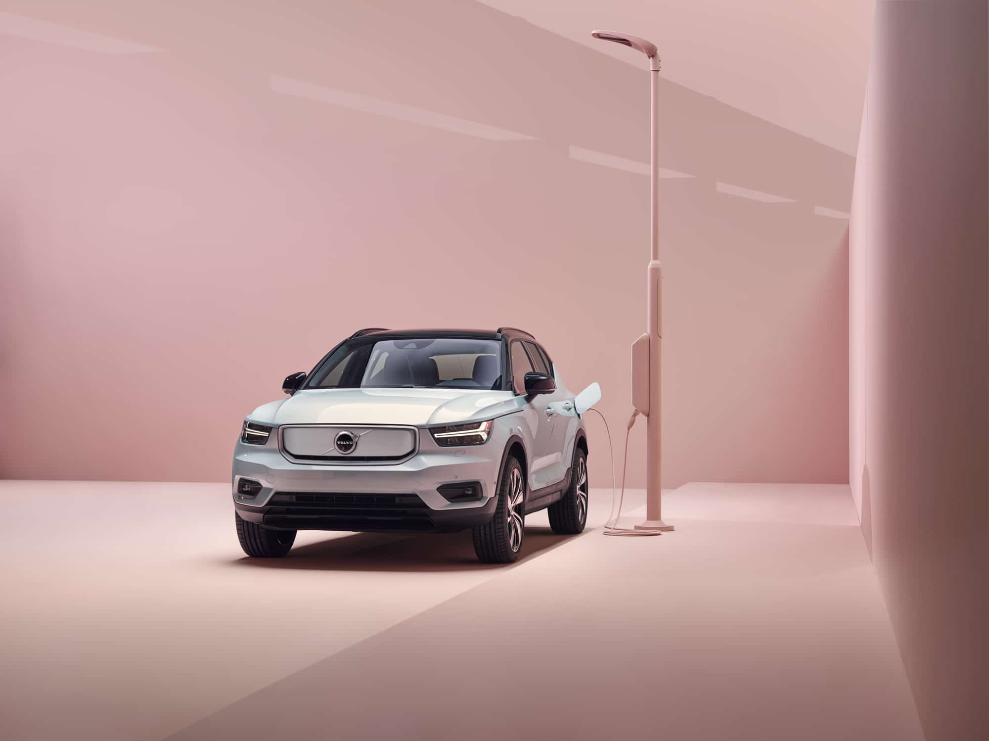 white ev charging on pink charging station with pink background